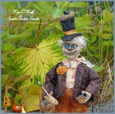 OOAK Primitive Halloween Scarecrow Cephus will light up your decor with his wide…