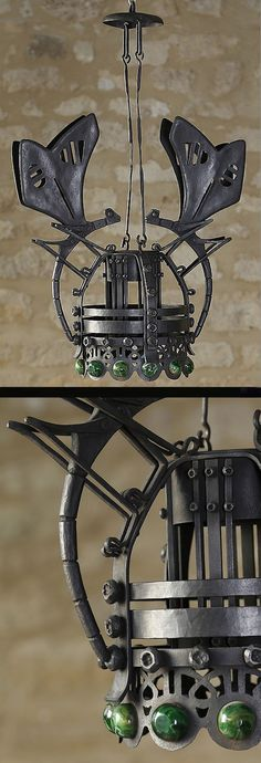 Alessandro Mazzucotelli (1865-1938) pendant light with two butterflies, wrought iron openwork with a green glass cabochon crown | to be auctioned APRIL 16, 2015, Fauve Auction Paris