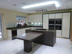 Stunning high gloss cream and dark oak units with truffle worktops.