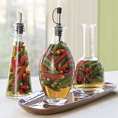 1/2 gal hot & mild peppers  2 cups white vinegar  1 c water  1/2 c olive oil  2 TBS canning salt  pack peppers in jars.  bring remaining ingredients to a boil and pour over peppers.  process in water bath for 10 minutes
