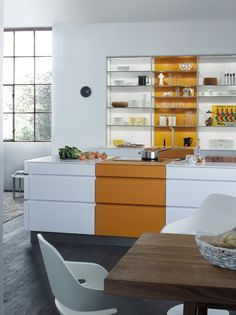 The stripe of yellow against the white gives this kitchen a classic, 50's feel. Very cool design!  Kitchen/ Kitchen island/ Kitchen island ideas/ Kitchen island DIY/ Kitchen island storage/ Kitchen island small/ Kitchen island large/ Kitchen island unique/ Kitchen island with sink/ Kitchen island with seating