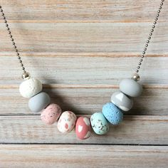 Handmade soft pastel coloured bead necklace. Each polymer clay bead has been individually hand rolled, giving them character. All strung on 28in long silver stainless steel ball chain. This is an original piece and I only use quality materials Happy shopping Offering Free shipping within Australia
