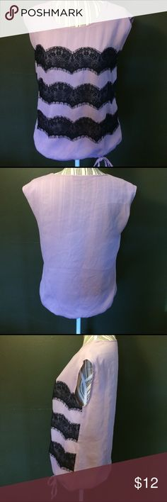"""Limited Purple Black Lace Detail Blouse Billowy pullover sleeveless purple blouse from The Limited with black lace detail across the front. Armpit to armpit 19 1/2"""". Armpit to bottom hem 16"""". Bottom hem is elastic and has a tie. Top is lined- you do not need a cami underneath. 100% polyester. Machine wash cold. No rips, holes, snags, stains. Smoke free home. The Limited Tops Blouses"""