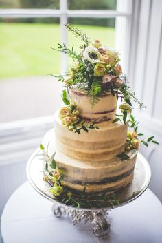 Half naked wedding cake with anemonies on top. LOVE https://mariaassia.com/emotional-nonsuch-mansion-wedding/ #weddingcake #nakedcake #gettingmarried #mariaassiaphotography #nonsuchmansion