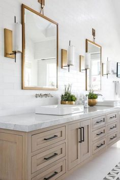 BECKI OWENS- Bathroom Trend: Warm Wood Vanities... Gold lights and mirror but chrome faucet