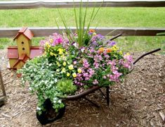 Wheelbarrow garden --- for the corner section of the backyard Garden Junk, Lawn And Garden, Garden Art, Potted Garden, Planter Garden, Planter Ideas, Wheelbarrow Planter, Barrel Planter, Flea Market Gardening