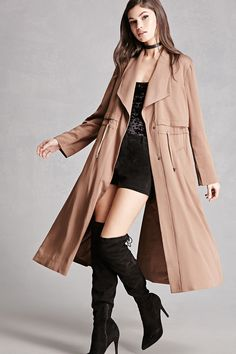 A midweight woven trench coat featuring a toggled drawstring waist, basic collar, snap-button front, front slant pockets, a storm flap, long button-cuffed sleeves, and a center-back vent. This is an independent brand and not a Forever 21 branded item.