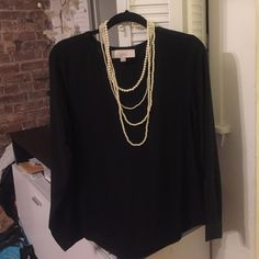 Black ann Taylor loft blouse Elegant black blouse, sleeves are semi-sheer, hangs beautifully. Slight scoop neck. Perfect for work or for dinner out! NWT! LOFT Tops Blouses