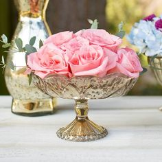 Our golden mercury glass bowl with pedestal base brings glam to any variety of events and performs beautifully as a small vessel for floral arrangements.