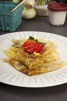 Homemade Crepes with strawberries and lemon sugar