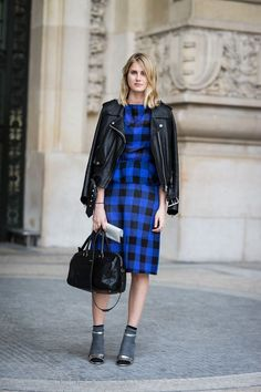 checked dress, leather jacket, and socks with sandaled heels