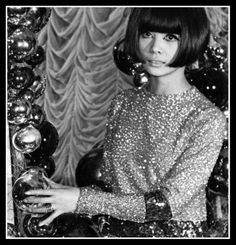 Hiroko (wearing couture by Pierre Cardin, A/W 1965/66) photographed at the Cardin Boutique in Paris (France), in December 1965.