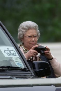 May England's Queen Elizabeth II taking photography of her unseen husband, Prince Philip, competing at the Royal Windsor Horse Show carriage driving dressage. (Photo by Ken Goff/The LIFE Images Collection/Getty Images) Elizabeth Philip, Queen Elizabeth Ii, Santa Lucia, Isabel Ii, Her Majesty The Queen, Queen Of England, Elisabeth, Famous Photographers, Queen Elizabeth