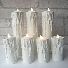 Have you always admired the magic of floating candles above your head? Now that can be a reality in your own home! This listing is for seven floating candles, four small and three large. Large candle: approximately 23cm or 9 inches. Small candle: approximately 13cm or 4.7 inches. There