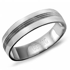 This 14k White Gold Gents Comfort Fit Wedding Band is a size 10. The 5.5mm ring has brushed edges and three thin lines in the center.