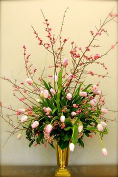 There are so many ways on Tulip Arrangement, now we will show you nice tips about Tulip Arrangement ideas that you can do it by yourself. One kind of flower arrangement popular in a wedding bouque… Spring Flower Arrangements, Flower Centerpieces, Spring Flowers, Flower Decorations, Tulip Arrangements, Floral Arrangement, Flower Vases, Altar Flowers, Church Flowers