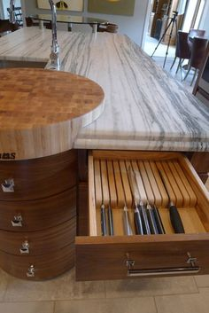 """Walnut horizontal grain kitchen by Susan Brook Interiors """"The Boos chopping board at the working end of the island is set into the marble, sitting on top of a bowed base cabinet."""" Columbus, IN, US 47201 ·   http://susanbrookinteriors.com"""