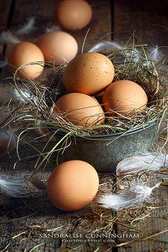 Fresh brown eggs on wood background, via Flickr.