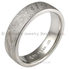 Platinum Mokume Wedding Band with a Heavy Etch - This mokume gane is made up of layers of three different metals: platinum, sterling and 14k palladium white gold. This extremely low contrast mokume needs to have an etch to best accentuate the contrast of colors of the metals. Our most subtle mokume for your wedding band. If you like a rugged look, but prefer a limited color contrast, the heavy etched Platinum Mokume Gane wedding band may be just for you. You will still have the woodgrain…
