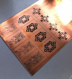Etching with transparencies - Print design on transparencies using a laser printer. Iron design onto metal, toner side down,  with the iron set to medium.