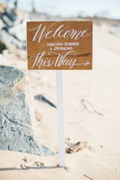 a welcome sign for a beach fete Photography: Natalie Franke - nataliefranke.com  Read More: http://www.stylemepretty.com/2014/06/03/coastal-glamour-a-nautical-inspired-photo-shoot/