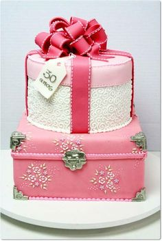 Stunning, chic, elegant, classic and modern gift box themed wedding cake in a palette of pink, ivory, red and silver.