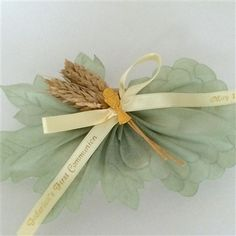 These personalized First Holy Communion favors are shaped like hanging grapes and decorated with stalks of real wheat and the IHS symbol. Jordan Almonds, Communion Favors, First Holy Communion, Ribbon Bows, Confetti, Holi, Symbols, Shapes, Flowers