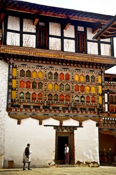EAST ASIA  Dzong in Paro, Bhutan. -  A Dzong is a distinctive type of fortress architecture found in the present and former Buddhist kingdoms of the Himalayas: Bhutan and Tibet. The architecture is massive in style with towering exterior walls surrounding a complex of courtyards, temples, administrative offices, and monks' accommodation.