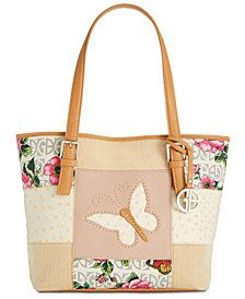 cba6298c931 Giani Bernini Patchwork Tote is loaded with pockets on the interior. You  will not go