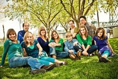 Large Family Portrait Poses Ideas | some nice green, but the girl in the back didn't know that mustard green wouldn't go.  I guess that's why she is back there!