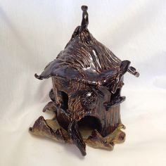 A personal favorite from my Etsy shop https://www.etsy.com/listing/228419563/creepy-gnome-house-candle-holder-2