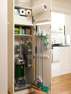 CLEANING CLOSET: finding a place to store cleaning supplies can be challenging, especially if storage space is limited. narrow closet nook corrals essential supplies near the kitchen. small bins organize bottles and brushes, and a door -mounted holder secures taller tools. wow, I definitely want this.
