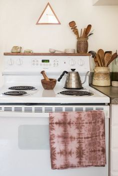 Wood above the stove...  House Tour: An Apartment With a Chill 1970s Feel | Apartment Therapy
