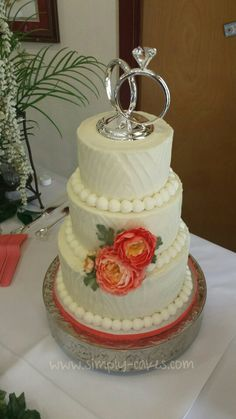 Beautiful textured wedding cake with coral flowers Www.facebook.com/simplycakes.brittneyshiley