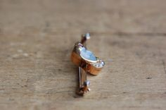 Antique Victorian man in the moon pin with ruby and pearls