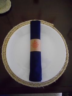 Nautical birthday party.  The napkin is a navy bandana from a craft store.  The napkin ring is made from brown card stock and stamped with a nautical compass.  Event Planner and Photo by: One Event Design.