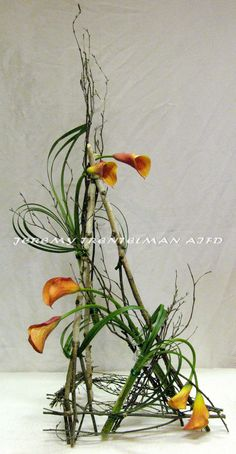 A Natural Movement: freestanding birch armature with fresh cut mango calla lilies and lily grass