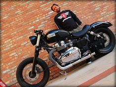 Triumph Speedmaster America with Thruxton tank, solo seat, chopped fender and laced wheels. Nice work.
