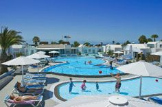 """Nautilus Bungalows in Puerto Del Carmen,Lanzarote. This place was great because who walk out your front door and there is the pool. The kids could swim and we could be inside and hear and see them. My only concern was that it didn't feel """"spotlessly"""" clean as some of the other reviews had mentioned. Our room also smelled of smoke. But you could walk to the beach!"""