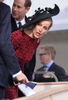 The Countess displayed the floral embellishment on the top of her hat as she leaned over to talk to a fellow member of the crowd