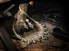 Indian Jewellery and Clothing: Beautiful short necklace studded with diamonds and emerald in the middle of the pendant..