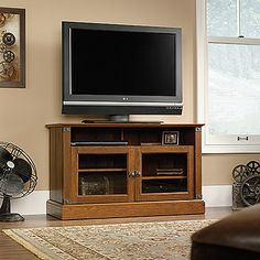 Accommodates up to a 47 in. TV weighing 95 lbs. or less.  Divided, open shelving holds audio/video equipment.  Adjustable shelf behind each framed, safety-tempered glass door.  Wrought iron style hardware and accents.  Enclosed back panel with cord access.  Washington Cherry finish.