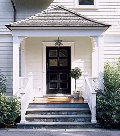 Used this as the model for my side entry: love the Moravian pendant, flared hip roof, bluestone steps, curved braces, fir porch, simple square columns, Dutch door, topiary, railings, finial-topped newel posts, built-in benches