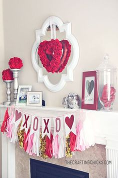 Valentine Mantle Inspiration with pretty DIY Tassels Garland in Pink, White and GOLD via The Crafting Chicks - Perfect for your home. Easy ways to decorate for a Valentine's Day party!