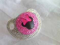 BLINKY'S Minnie Mouse decal rhinestone pacifier with crystal bling. $35.00, via Etsy. Cute! But way overpriced. D.I.Y!