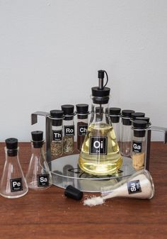 As an organic chemist, you put your lab skills to good use while experimenting in the kitchen with this spice rack set. With nine petite test tubes and four Erlenmeyer flasks - one large and three smaller - as well as labeling stickers for a bevy of spices in the style of the elemental table, this set - complete with holding tray - brings geeky flavor to your dinner table!