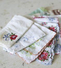 vintage hankies. I still have some of these. Grandma taught me that all ladies carry one in their pocketbook (purse).