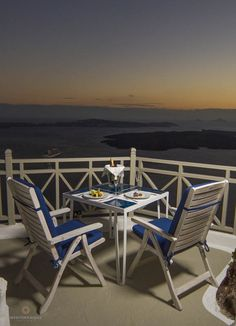 Sunset dining on a terrace in Oia village, Santorini island, Greece. - selected by www.oiamansion.com