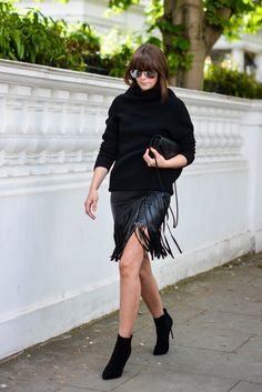 EJSTYLE - Emma Hill wears River Island faux leather fringe tassel skirt, Romwe black jumper, heeled ankle boots, YSL quilted envelope clutch bag, all black OOTD, street style