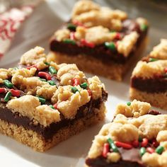 Trust us, adding fudge to peanut butter bars makes a difference. Heat our sweetened condensed milk & chocolate, then stir in butter. Add peanut butter, more butter, eggs, vanilla & almond to a sugar cookie mixture. Spread the chocolate over the crust, dust crumbs on top & bake. Finish with as many sprinkles as your heart desires. It's that simple and fun!